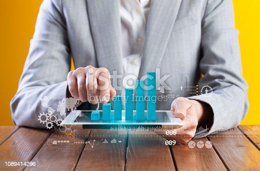 693586040istockphoto Businesswoman analyzing graph on digital tablet 1089414296