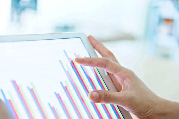 Businesswoman analyzing graph stock photo