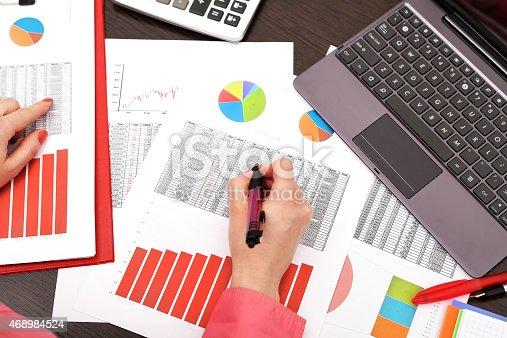 istock businesswoman analyzing investment charts 468984524