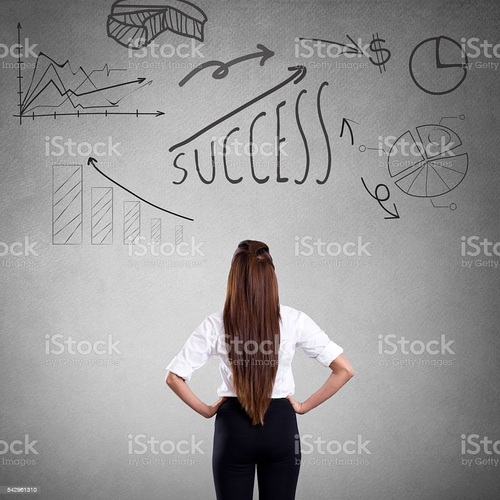 Businesswoman analyzing progress report stock photo