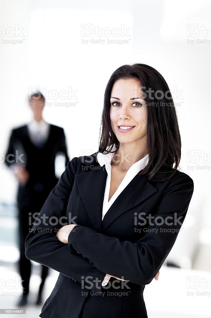 Businesswoman and Businessman in Lobby royalty-free stock photo