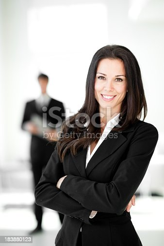 istock Businesswoman and Businessman in Lobby 183880123