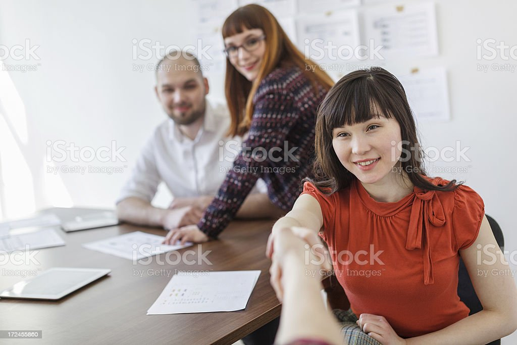 Businesswoman and businessman shaking hands royalty-free stock photo