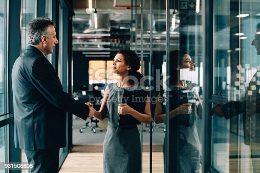 istock Businesswoman and businessman shaking hands. 931508808