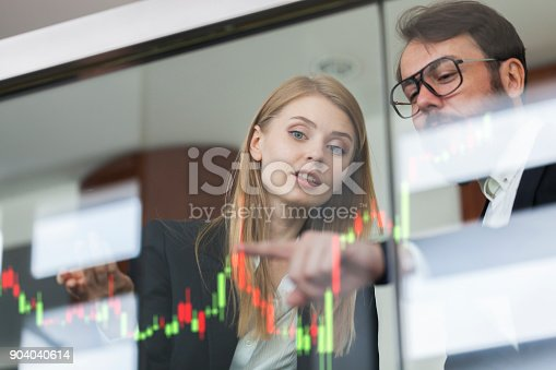 istock Businesswoman and businessman talking profit on  futuristic display 904040614