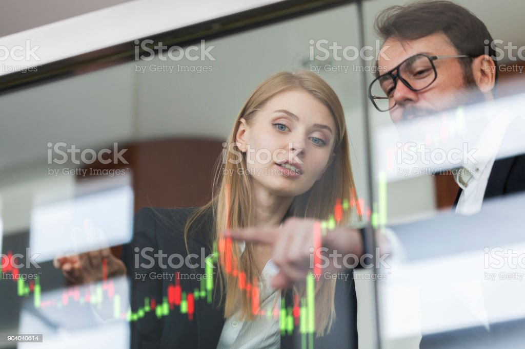 Businesswoman and businessman talking profit on  futuristic display stock photo