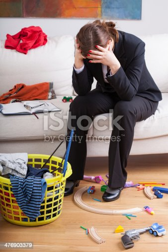 istock Businesswoman and children's mess 476903379