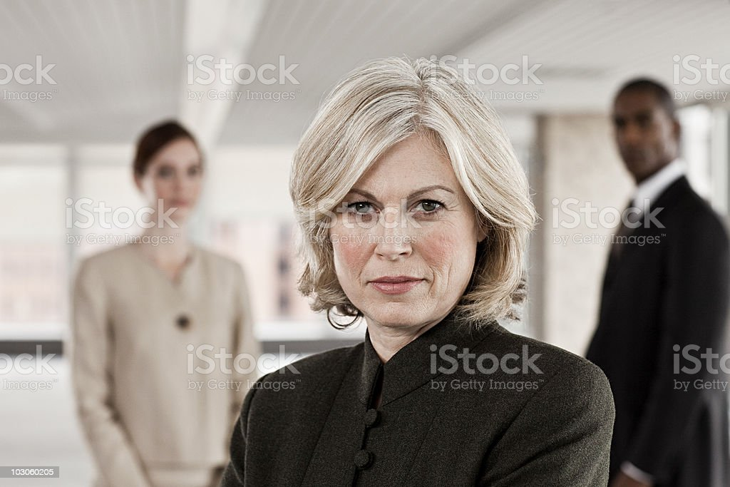 Businesswoman and colleagues stock photo