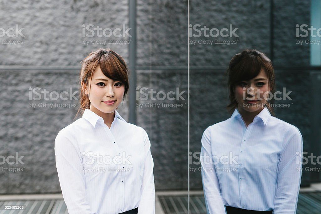 Businesswoman and her Reflection stock photo
