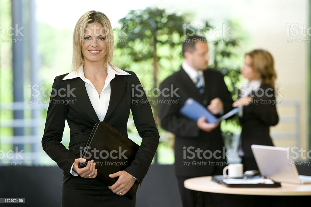 Businesswoman and Her Team royalty-free stock photo