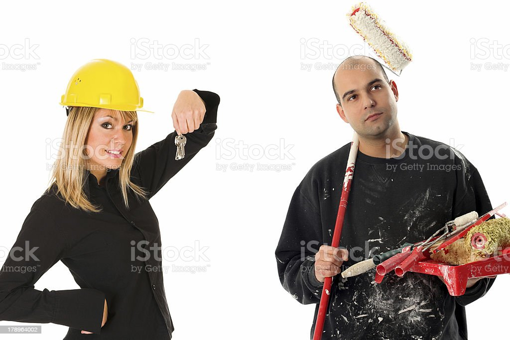 businesswoman and house painter royalty-free stock photo