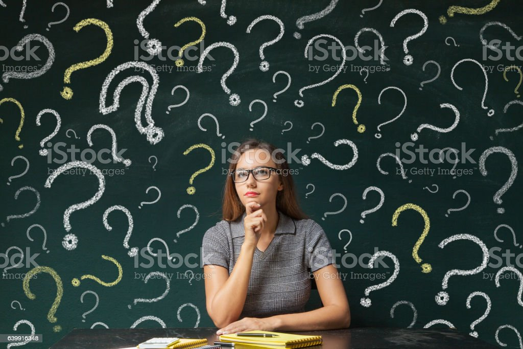 Businesswoman and question mark on blackboard stock photo
