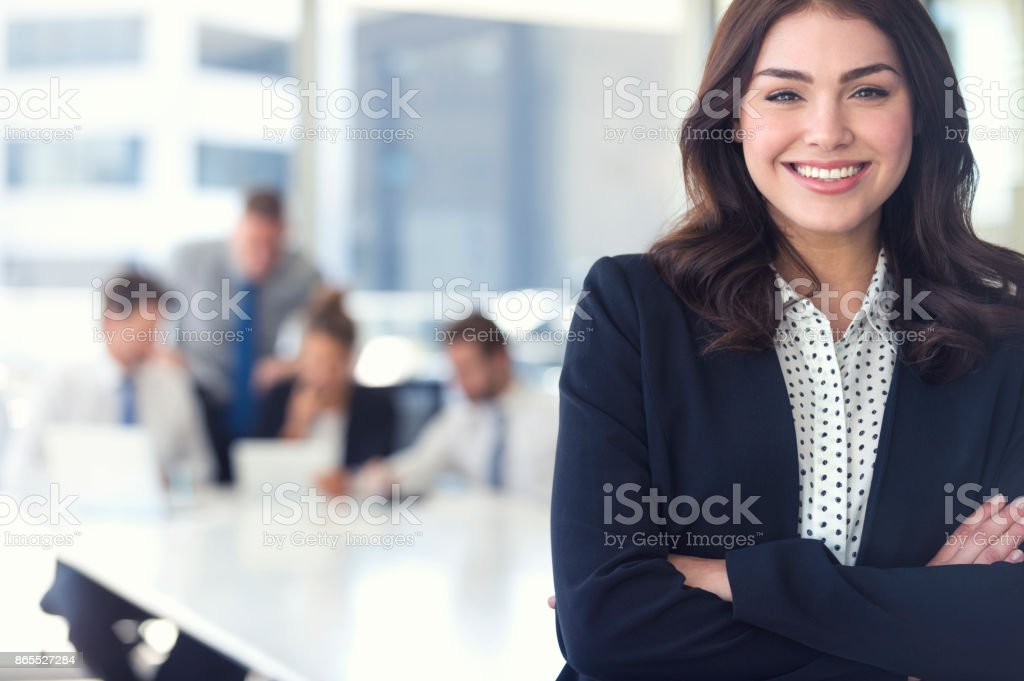 Businesswoman and team at the office. stock photo