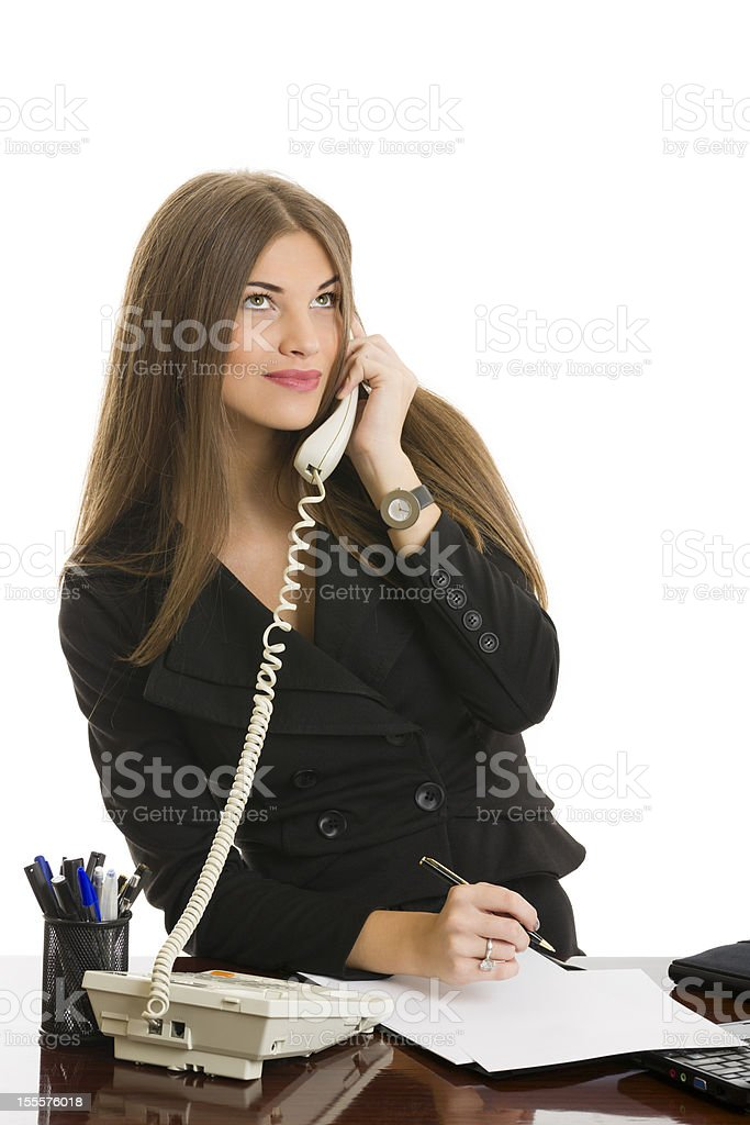 Businesswoman answering the phone royalty-free stock photo
