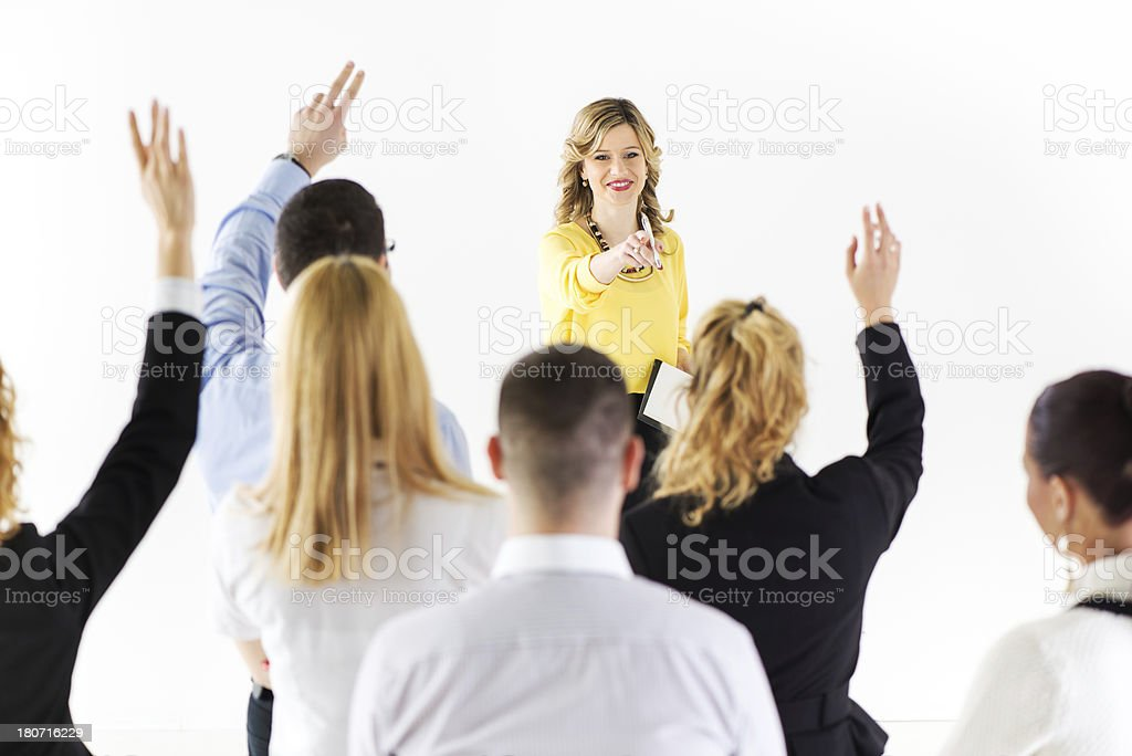 Businesswoman answering the questions stock photo