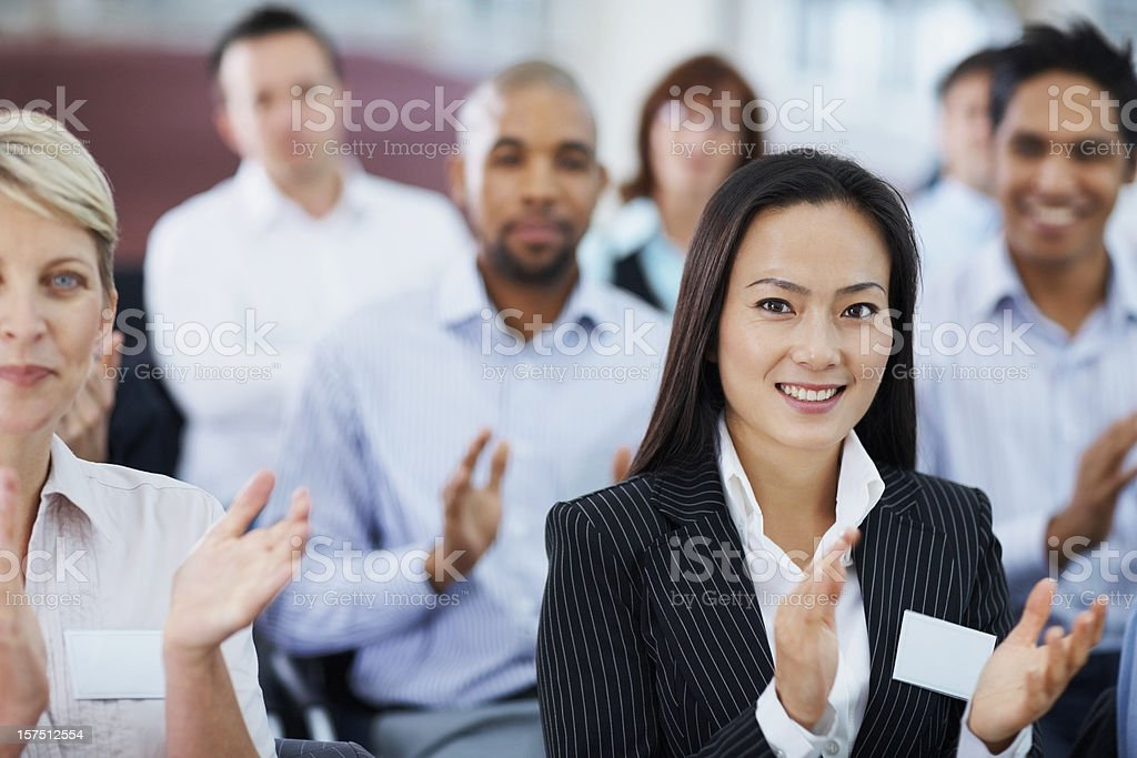 Businesswoman applauding at a seminar royalty-free stock photo
