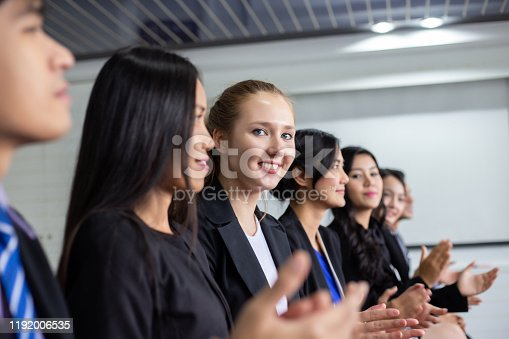 505413934 istock photo Businesswoman applauding at a seminar with colleagues 1192006535