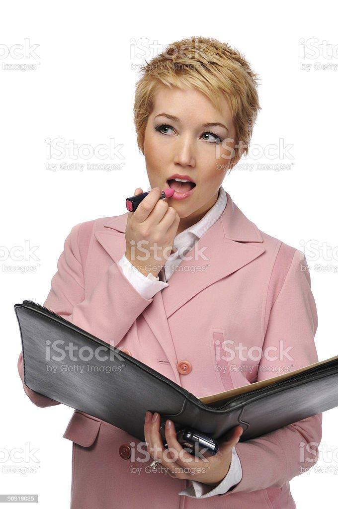 Businesswoman applying lipstick royalty-free stock photo