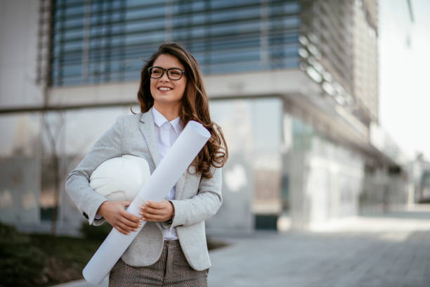 Businesswoman, Architect, Blueprint, Engineer. Business woman with project stock photo