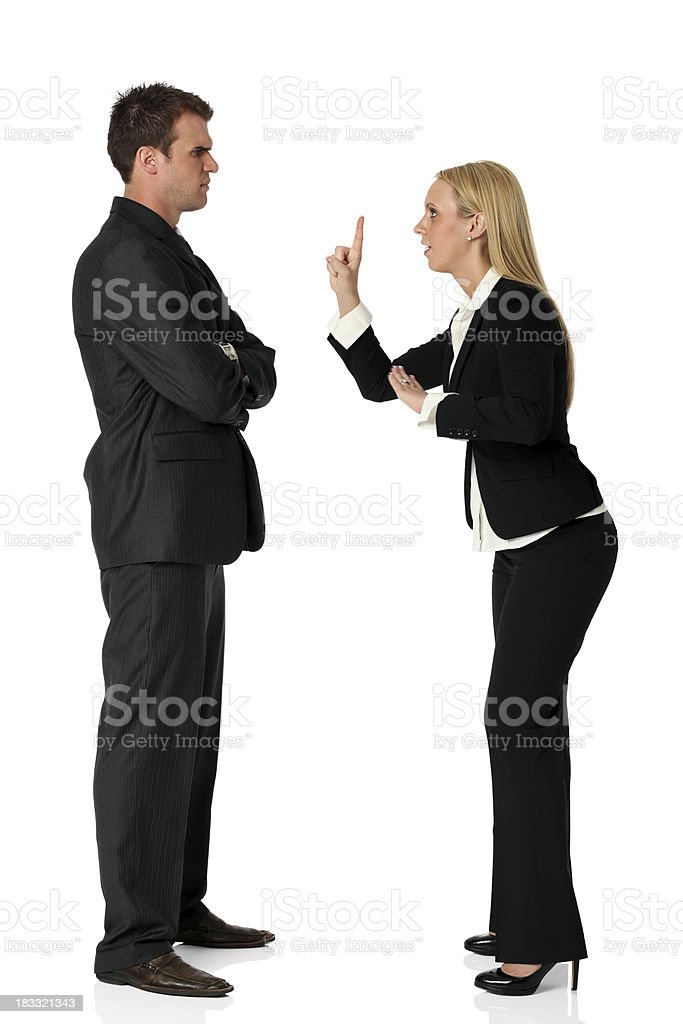 Businesswoman arguing with a businessman royalty-free stock photo