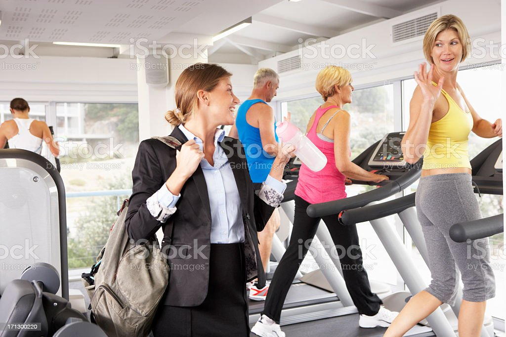 Businesswoman Arriving At Gym After Work royalty-free stock photo