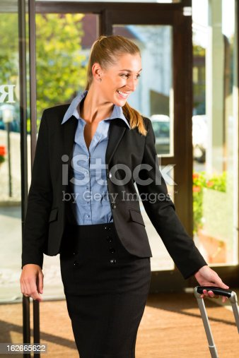istock Businesswoman arriving at Hotel 162665622