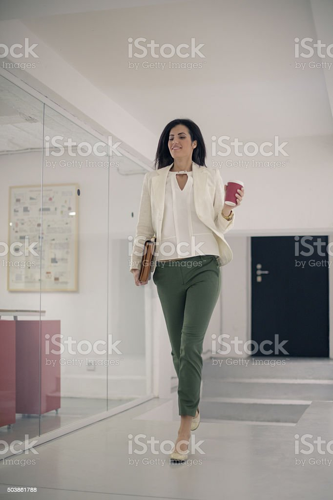 Businesswoman arriving at work stock photo