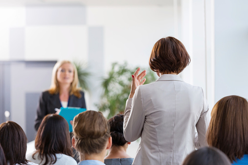 Businesswoman Asking A Question During Seminar Stock Photo - Download Image Now