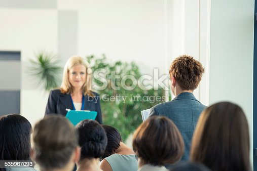 1028234706 istock photo Businesswoman asking a question during seminar 535967093