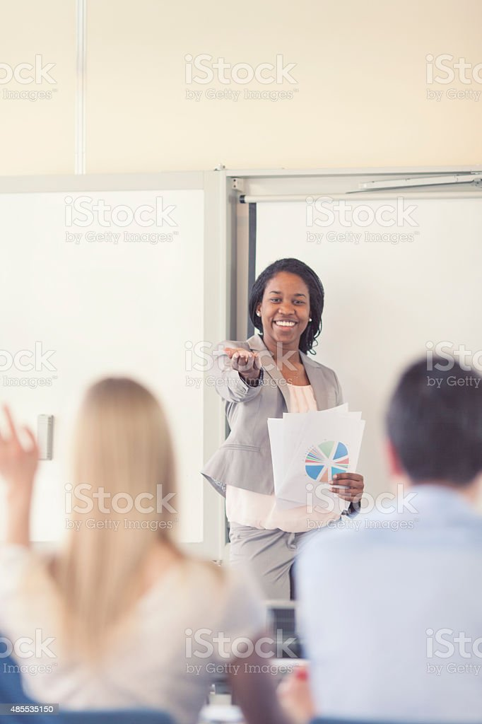 Businesswoman asking a question stock photo