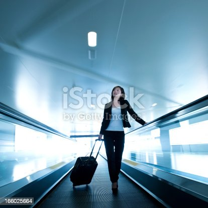 istock businesswoman at airport 166025664