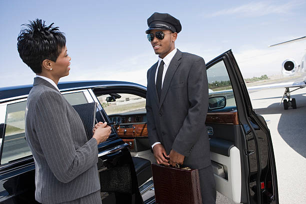 businesswoman at airport - limousine service stock photos and pictures