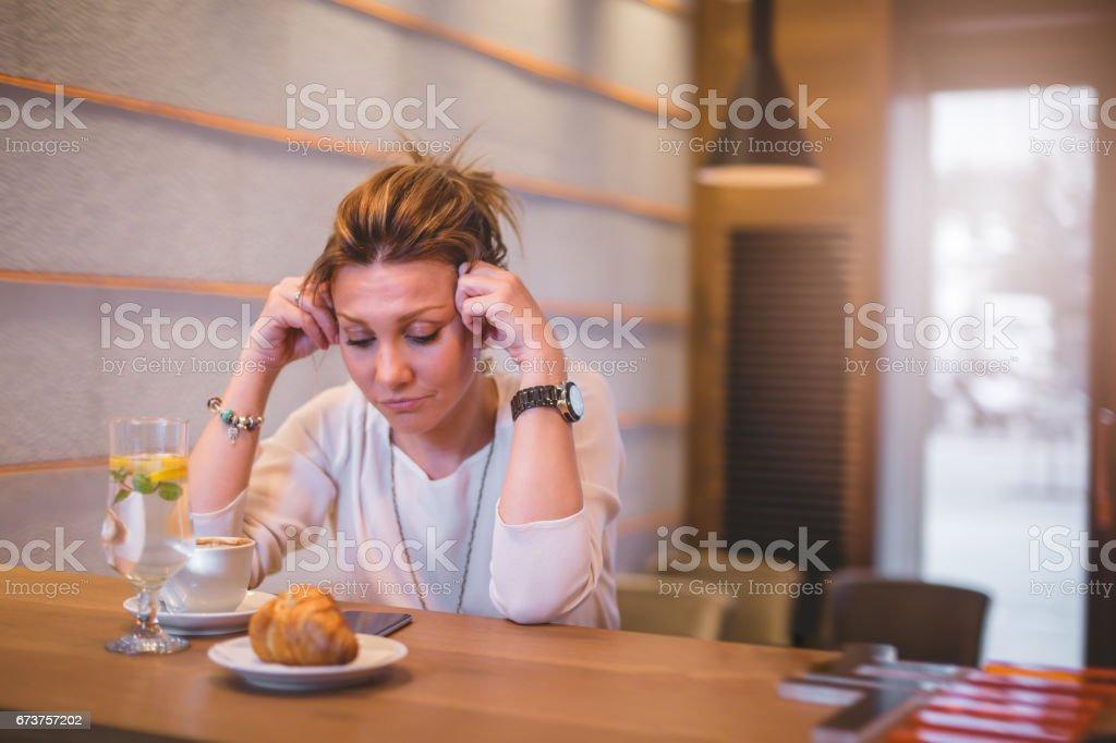 Businesswoman at coffee break having a headache stock photo