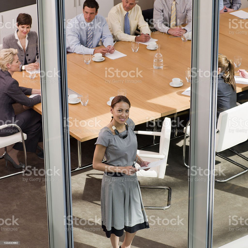 Businesswoman at conference room window royalty-free stock photo