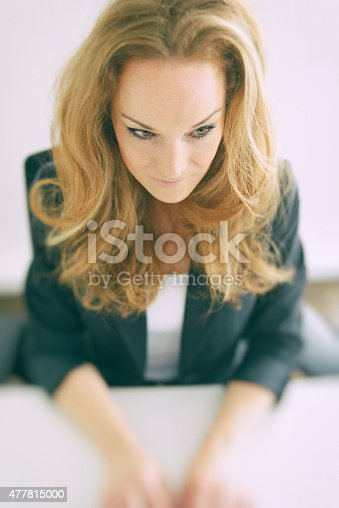 Businesswoman At Desk Concentrating On Using Computer Stock Photo & More Pictures of 2015