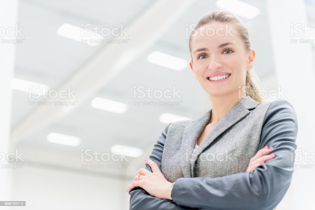 Businesswoman at distribution warehouse smiling stock photo
