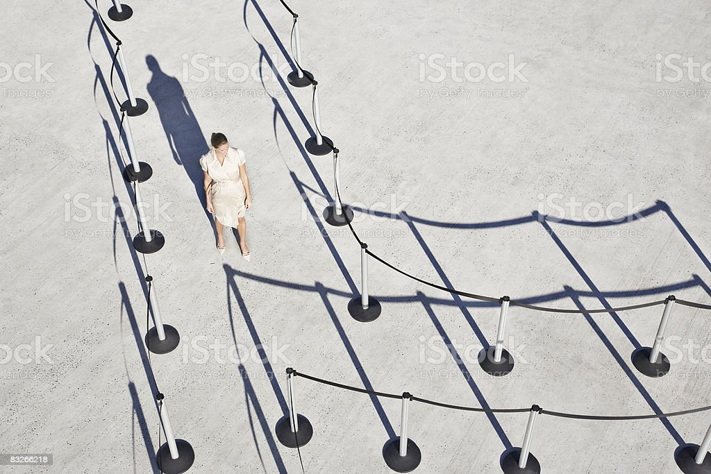 Businesswoman at fork in cordon posts royalty-free stock photo