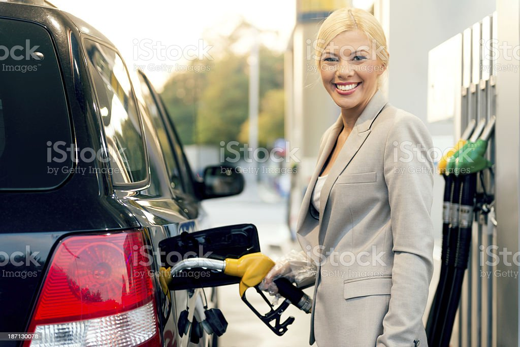 Businesswoman at gas station stock photo