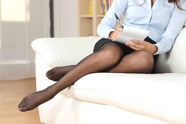 businesswoman at home taking notes - black women wearing pantyhose stock photos and pictures