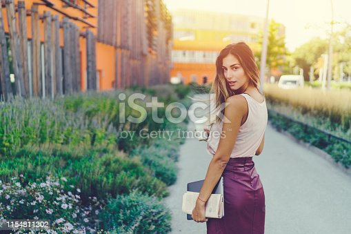 Young businesswoman outside looking at camera