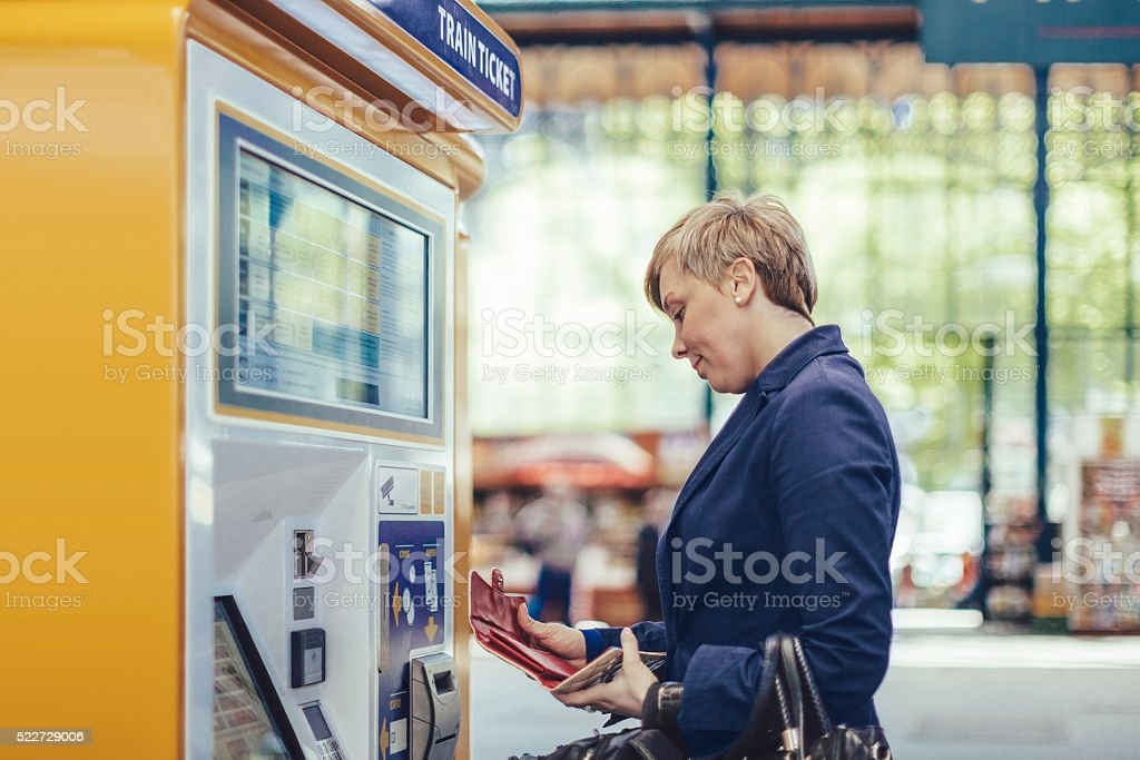 Businesswoman at the train station stock photo