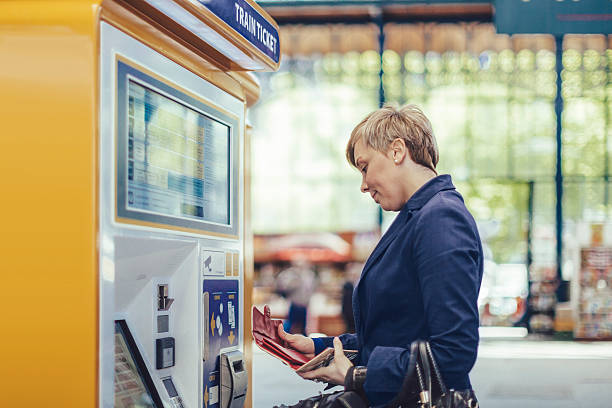 Businesswoman at the train station Businesswoman at the train station train ticket stock pictures, royalty-free photos & images
