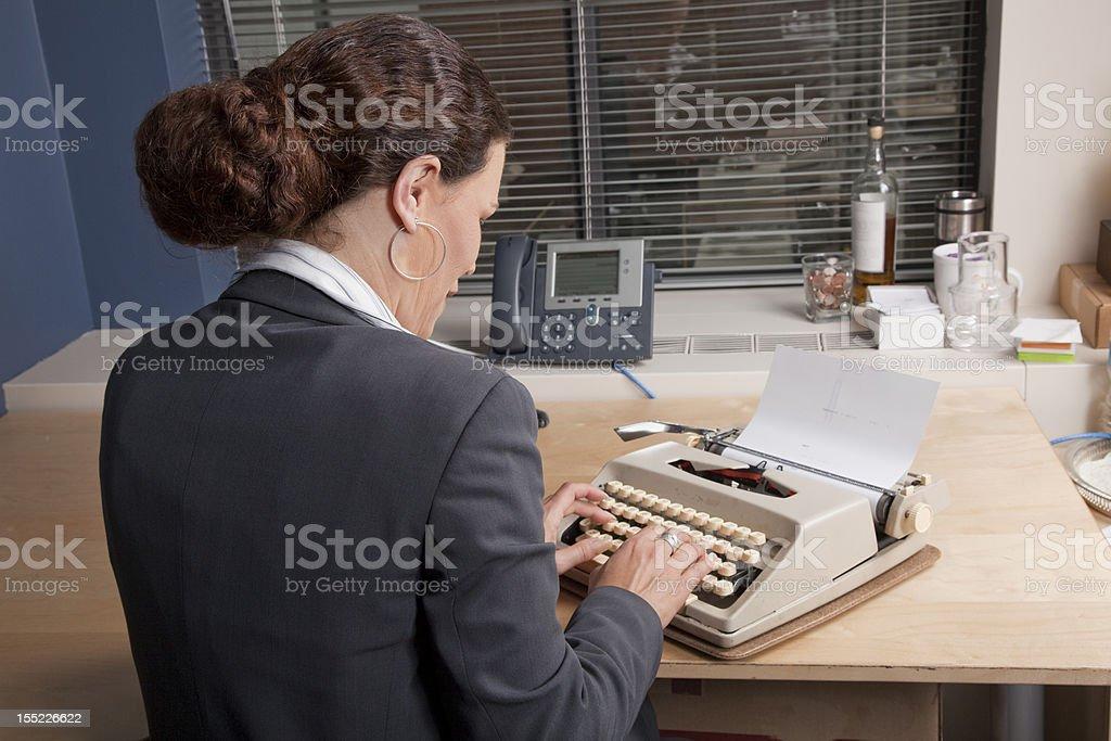 Businesswoman at typewriter royalty-free stock photo