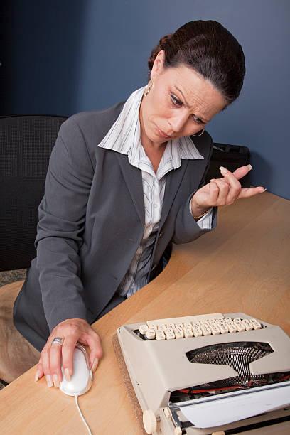 Businesswoman at typewriter stock photo