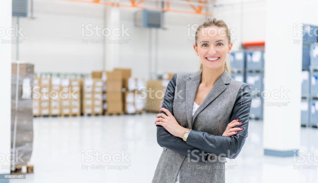 Businesswoman at warehouse stock photo