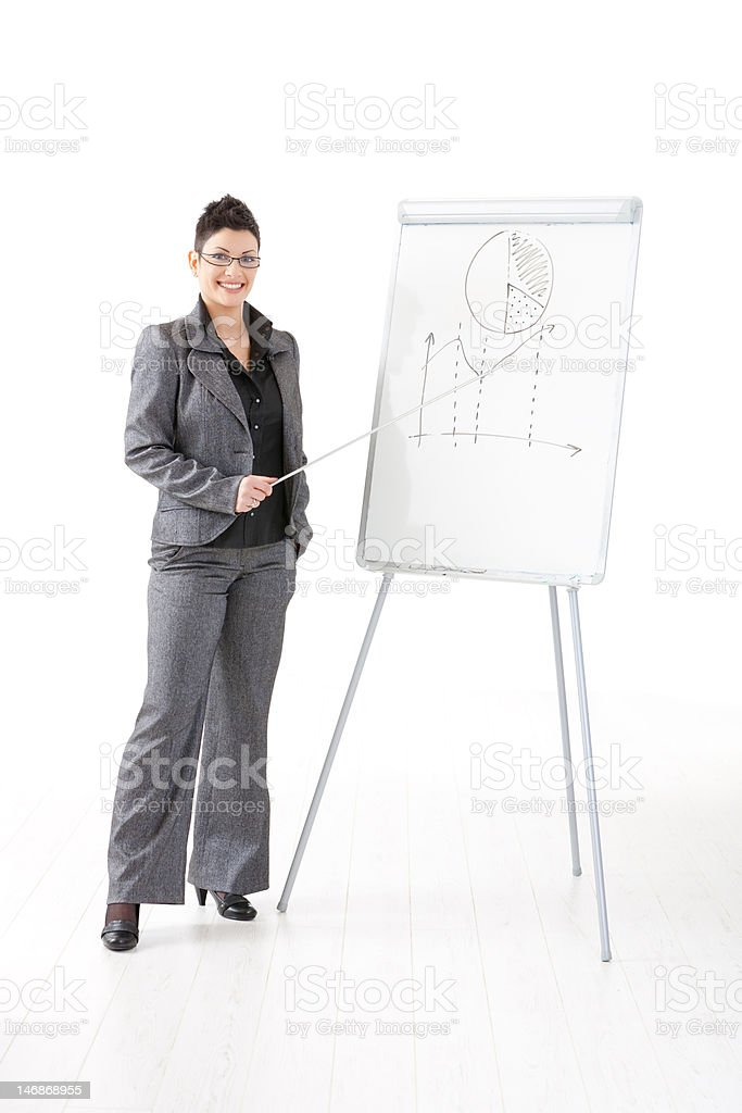 Businesswoman at whiteboard stock photo