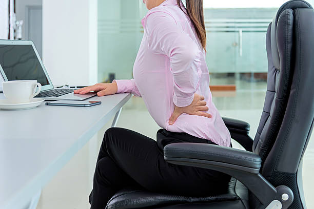 businesswoman backache - low section stock photos and pictures