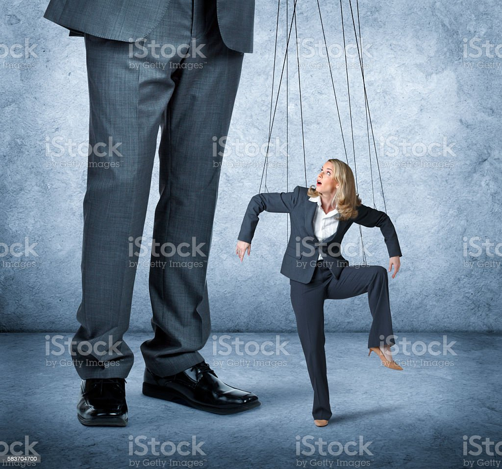 Businesswoman Being Controlled Like A Marionette stock photo