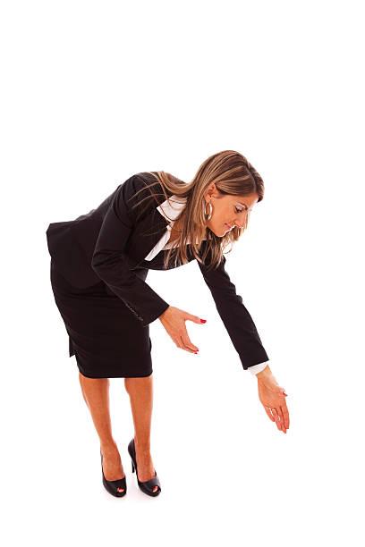 Businesswoman bending over stock photo
