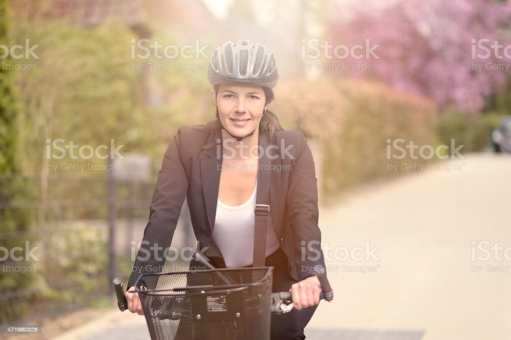 Businesswoman Biking at the Street with Helmet stock photo